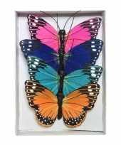 Vergelijk 12x gekleurde decoratie vlinders 9 cm op draad prijs
